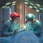 This is an image of two doctors performing surgery.