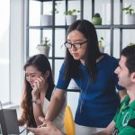 This is an image of a technical communicator speaking with her team.