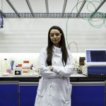 This is an image of a female toxicologist in the lab.