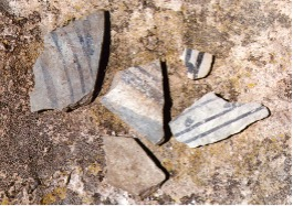 This is an image of pottery shards that were found at an archaeology site at Bandelier National Monument.